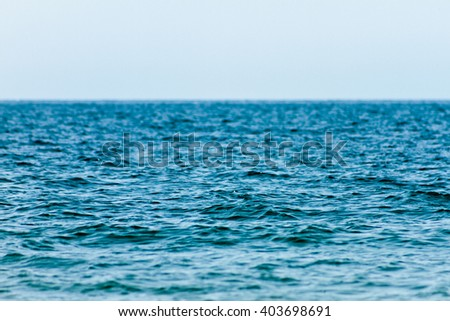 ripples on the surface of the lake with depth of field - stock photo