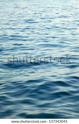 Rippling blue water surface - stock photo