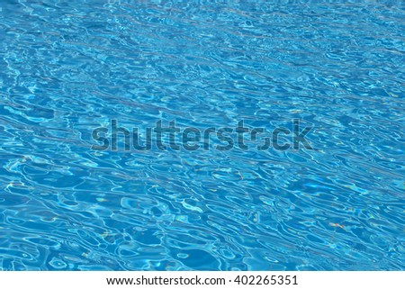Rippling water in a pool. Bright blue water background - stock photo