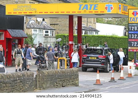RIPPONDEN, WEST YORKSHIRE - SEPTEMBER 3 2014: Film crew filming a scene for  comedy TV series at the local petrol station in Ripponden - stock photo