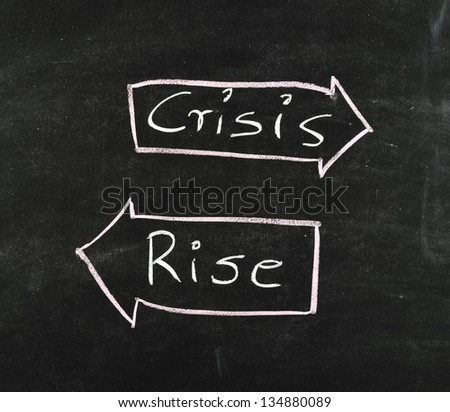rise and crisis concept on blackboard