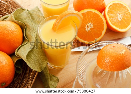 Rise and Shine - it's time to wake up to a healthy breakfast treat with fresh squeezed orange juice. - stock photo