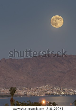 Rise of full Super-moon on August, 2014 above the gulf of Aqaba, Red Sea - stock photo