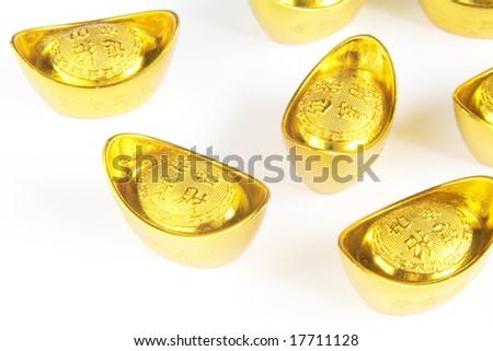 Rise of the Asian Economy Symbolized Through Gold Ingots - stock photo
