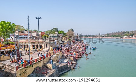 RISHIKESH, INDIA - APRIL 5, 2010: View of Rishikesh and the Ganges river from Ram Jhula bridge.