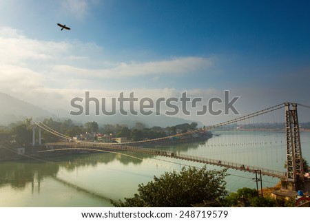 RISHIKESH, INDIA - JAN 05: Bridge over Ganga River on January 05, 2015 - stock photo