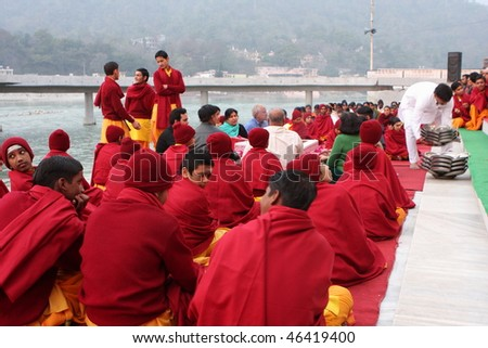 RISHIKESH, INDIA - JANUARY 19: Hindu students from the Parmath Niketan Ashram hold ceremonial lanterns during the daily aarti prayer on the River Ganges, January 19, 2009 in Rishikesh, India.
