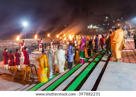 RISHIKESH, INDIA - NOVEMBER 08, 2015: Ganga Aarti ceremony in Rishikesh, India. It is a Hindu ritual of worship, in which light from wicks soaked in ghee is offered to deity. - stock photo