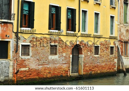 Rising damp in Venice rots the exterior covering of this house
