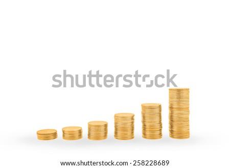Rising gold coin stacks - stock photo