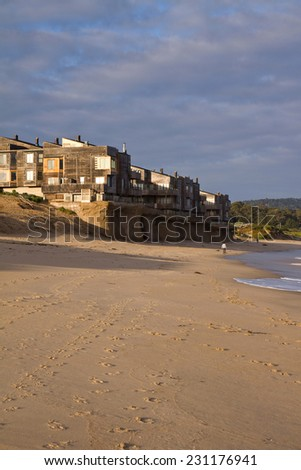 Rising Sea level. Beachfront condo development being undermined by rising ocean levels, Monterey Bay, California, USA - stock photo