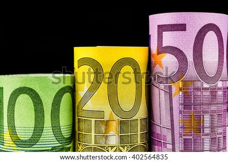 rising steps made of big euro banknotes on black background - stock photo