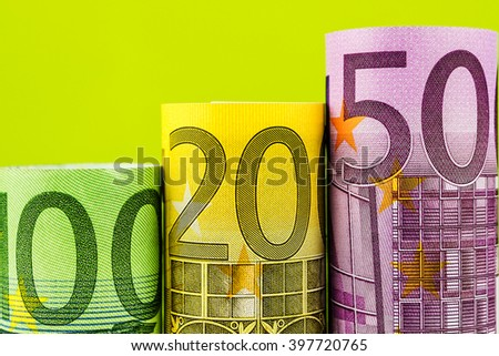 rising steps made of big euro banknotes on green background - stock photo