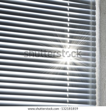 rising sun behind the blinds - stock photo
