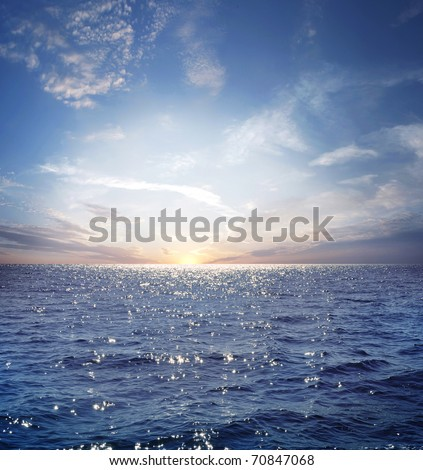 rising sun on the horizon, blue sea, ocean - stock photo