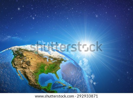 Rising sun over the Earth and its landforms, view of the United States of America. Elements of this image furnished by NASA - stock photo