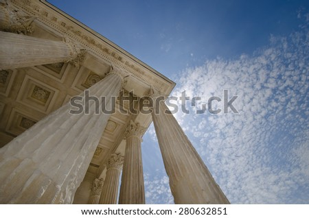 Rising tall stone columns - concept for Law and Justice.  Symbols of integrity, stability, and trust - stock photo