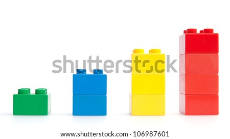 Rising trend described by plastic blocks - stock photo