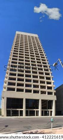 Rising up  to blue sky tall office building in downtown of Phoenix, AZ - stock photo