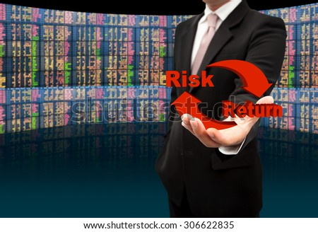Risk and return symbol on hands. - stock photo