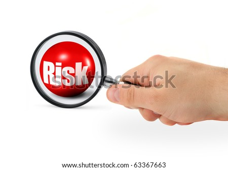 risk concept - hand with magnifying glass on white