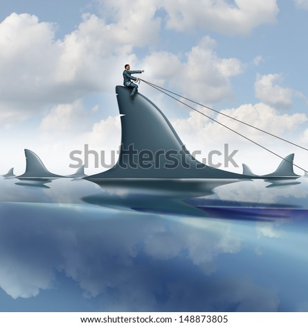 Risk control business concept with a courageous businessman riding a dangerous shark in the ocean guiding it for success controlling and managing uncertainty as a symbol of leadership . - stock photo