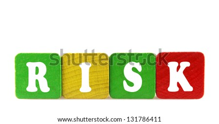 risk - isolated text in wooden building blocks - stock photo