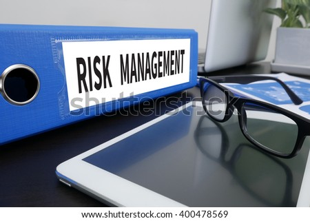 RISK MANAGEMENT Concept Office folder on Desktop on table with Office Supplies. ipad - stock photo