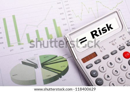 risk management concept with calculator showing financial success - stock photo