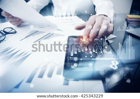 Risk Management Work process.Photo Trader working Market Report Documents Touching Screen Tablet.Using Graphic Icons,Stock Exchanges Reports. Business Project Startup. Horizontal, Flares Effect. - stock photo
