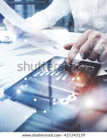 Risk Management Work process.Picture Trader working Market Report Document Touching Screen Tablet.Using Worldwide Graphic Icons,Stock Exchanges Reports.Business Project Startup. Vertical,Flares Effect - stock photo