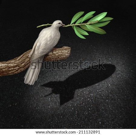 Risk of war concept as a freedom peace charlatan dove holding an olive branch casting a shadow that is shaped as a bomb as a symbol of the danger of warfare by pretending to be peaceful. - stock photo