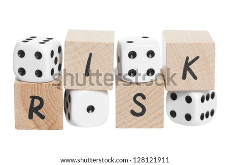 Risk spelt with wooden blocks. White background.