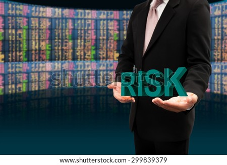 Risk text on hands businessman. - stock photo