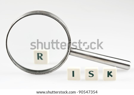 Risk word and magnifying glass - stock photo