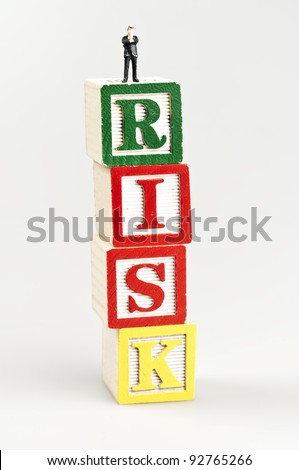 Risk word and toy business man