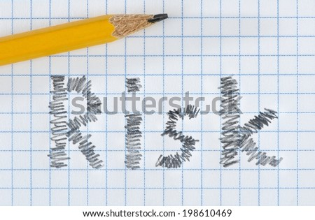 Risk word typed on white paper and yellow pencil. - stock photo