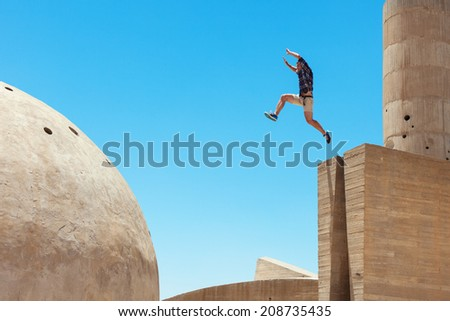 risky man jumping, in little motion blur - stock photo