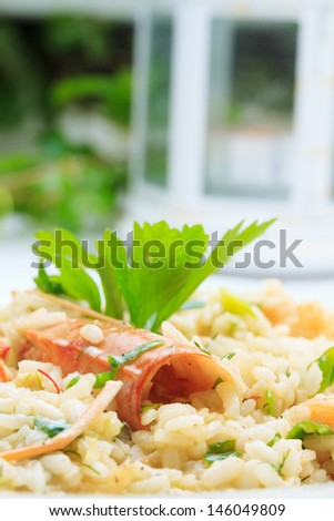risotto at the restaurant table - stock photo