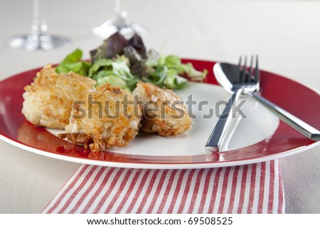 Risotto balls with a side salad.