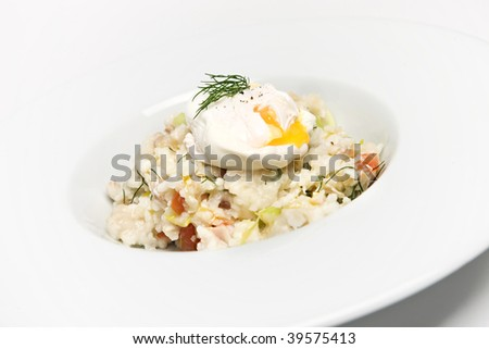 Risotto rice with a poached egg - stock photo