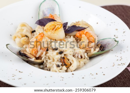 Risotto, rice with seafood, food closeup - stock photo