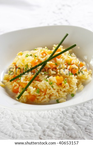 Risotto with boiled pumpkin pieces - stock photo