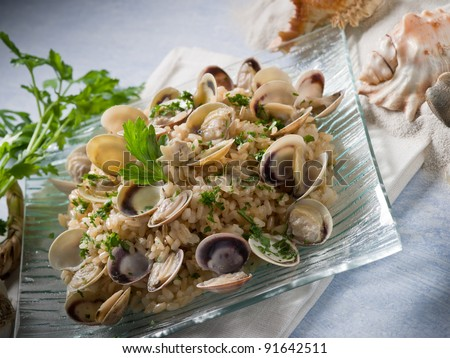 risotto with clam and parsley - stock photo