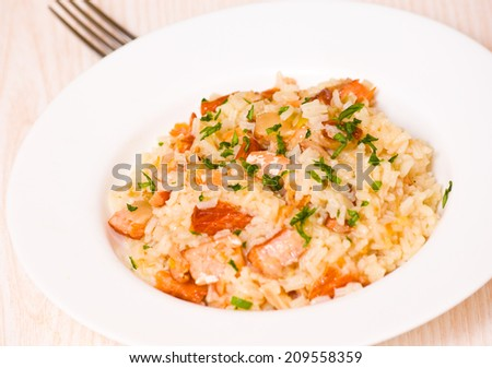 risotto with fish - stock photo