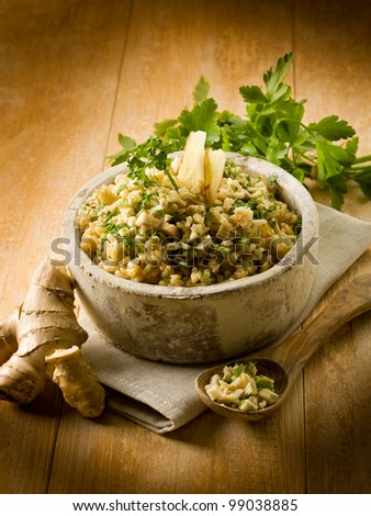 risotto with ginger and parsley, healthy food - stock photo