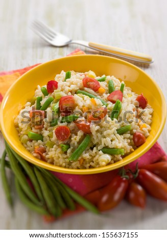 risotto with green beans and tomatoes, selective focus