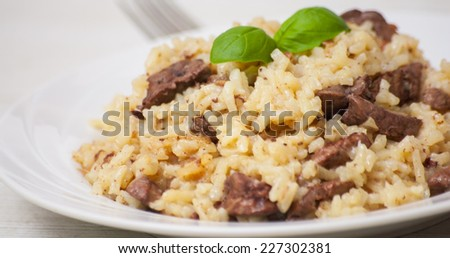 Risotto with liver - stock photo