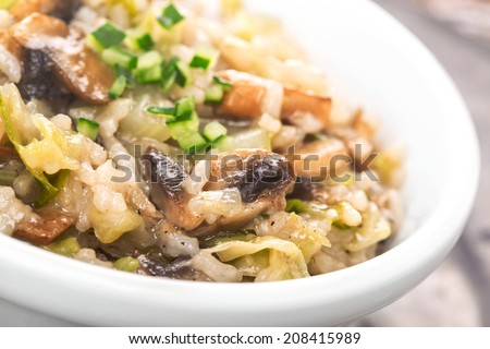risotto with mushrooms and cucumbers - stock photo