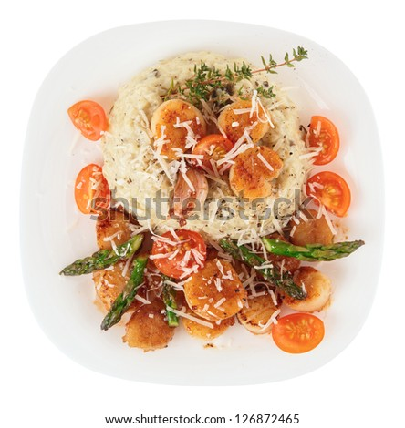 Risotto with pan seared sea scallops isolated on white background - stock photo